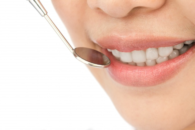 close-up-of-woman-in-a-dental-checkup_1232-217